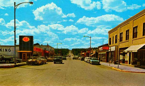 Main Street looking west to Highway 61, North Shore Drive as it enters the village from Duluth, Grand Marais, 1958