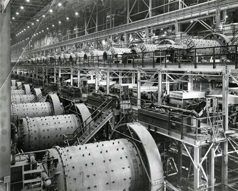 Interior of concentrator building with ball mills at Erie Mining Company, Hoyt Lakes Minnesota, 1950