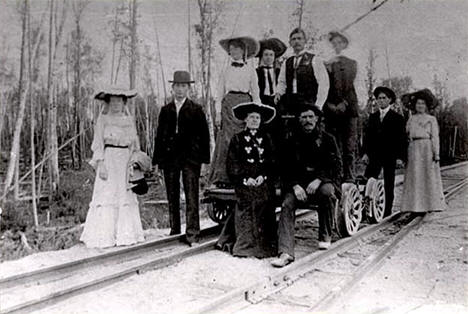 Tenstrike citizens using a railroad handcar to get to a social gathering, 1905