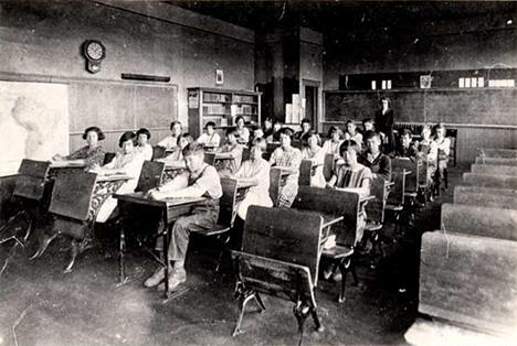 Students and teacher in a Tenstrike school classroom, 1920