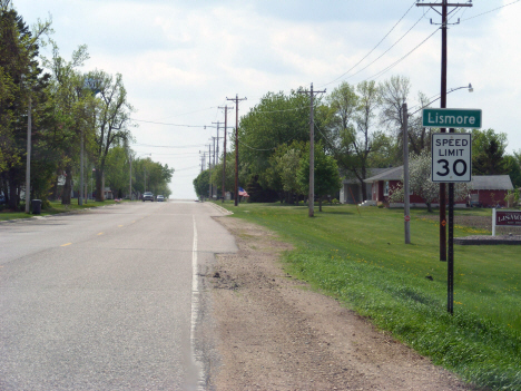 Road sign and street scene, Lismore Minnesota, 2014