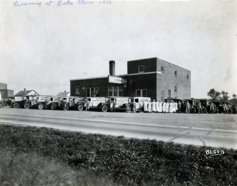 Arrowhead Co-Op Creamery Building with trucks and staff, downtown Esko, Esko Minnesota, 1926