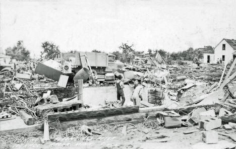 Picking up belongings after the tornado, Anoka Minnesota, 1939